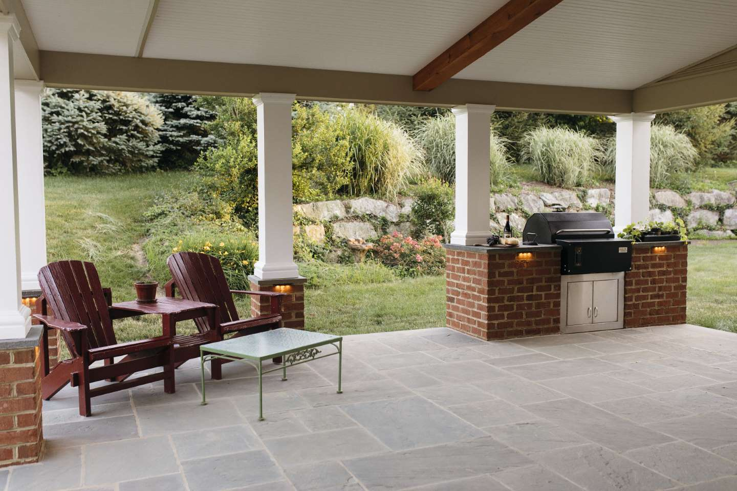 outdoor stone patio and grill